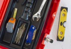 Orange Tool Box Wrench Measuring Tape and Level. Orange Tool Box with Crescent Measuring Tape Level Boxcutter Screws and Multi Purpose Tool Stock Photo