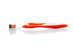 Orange toothbrush on white Royalty Free Stock Image