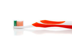 Orange toothbrush on a white background Stock Images
