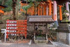 Orange Torii, prays and fountain stock image