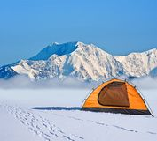 Orange touristic tent in a mountains Stock Image
