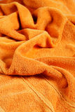 Orange towel Stock Images