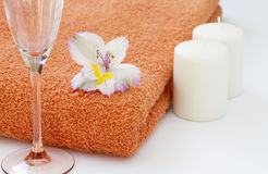 Orange towel with candles Royalty Free Stock Image
