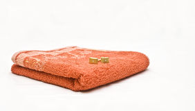 Orange towel and cuff links Stock Images