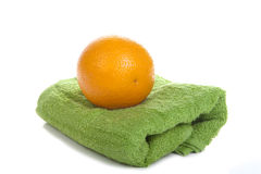 Orange and towel isolated on a white background Royalty Free Stock Image