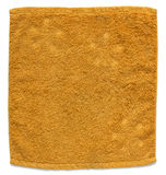 Orange towel isolated on white Royalty Free Stock Photography