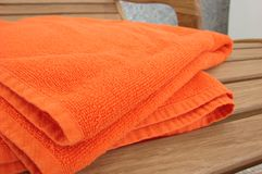 Orange towel lay on the wood c Royalty Free Stock Images
