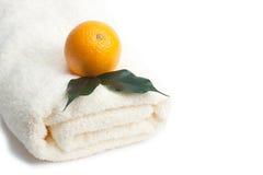 Orange and towel on white Royalty Free Stock Image