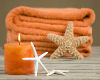 Orange towels with candle Royalty Free Stock Images