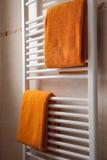 Orange towels on heater Stock Photo