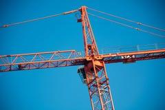 Orange tower crane over blue sky Royalty Free Stock Photos