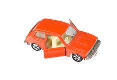 Orange toy car isolated on a white Stock Photos
