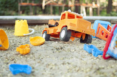 Orange toy car Stock Images