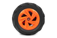 Orange toy car wheel isolated on white background.  royalty free stock image