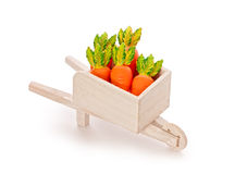 Orange toy carrot in a wooden shopping cart  with Clipping Path Royalty Free Stock Photos
