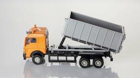 Orange toy dump truck stock video footage