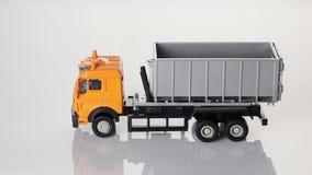 Orange toy dump truck stock footage