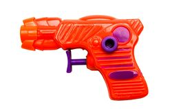 Orange toy gun. Isolated over white Royalty Free Stock Photography