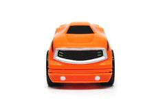 Orange Toy Race Car Front. Front View of Orange Plastic Toy Race Car Royalty Free Stock Photography