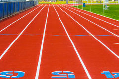Orange Track & Field Racing Track. Orange Running Track With Designated Lanes Stock Photography