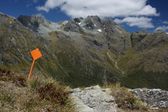 Orange track pointer in Southern Alps Royalty Free Stock Photo