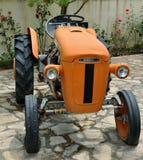 Very old Orange tractor Stock Image