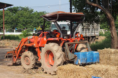 Orange tractor in a farm Stock Photos