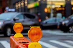 Orange traffic barrier barrels to detour traffic around construction zone shallow depth stock image