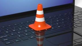Orange traffic cone on black laptop Stock Images