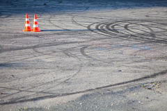 Orange traffic cone. Color image of two traffic cones on tarmac Royalty Free Stock Photos