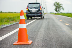 Orange traffic cone on country road Stock Photo