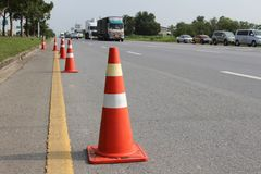 Orange traffic cone and diversion on country road,Thailand.  stock photo