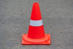Orange traffic cone. On asphalt royalty free stock photography