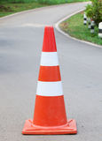 The orange traffic cone in the road.  Royalty Free Stock Photo