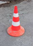 An orange traffic cone on the road Stock Photography