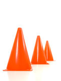 Orange traffic cones. Lined up in a row, warning cones Royalty Free Stock Photo