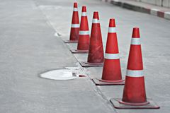 Orange traffic cones in the middle of the street. It`s for prevent car Stock Photography