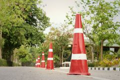 Orange traffic cones on the road at the park. Royalty Free Stock Photo