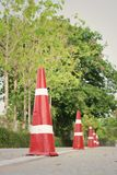 Orange traffic cones on the road at the park. Stock Photography