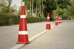orange traffic cones on the road at the park. Stock Image