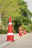 Orange traffic cones on the road at the park. Royalty Free Stock Photography