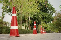 Orange traffic cones on the road at the park. Stock Photos