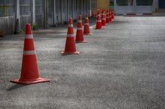 Orange trafikkottar Arkivfoto