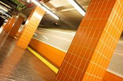 Orange train. Orange line train stop on the mbta in boston massachusetts with train in motion Stock Photos