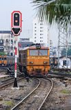 Orange Train locomotive approaching to Bangkok Rai Stock Photos