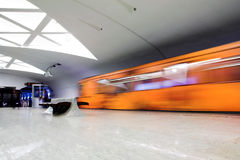 Orange train on platform Stock Image