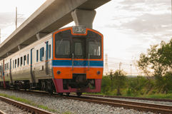 Orange train, railroad locomotive traveling ,Thailand Stock Photography