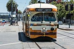 Orange tram in San Francisco. San Francisco,California,USA - June 11, 2015 : The orange beige street car at the Embarcadero Stock Image