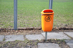 Orange trash bin Royalty Free Stock Image