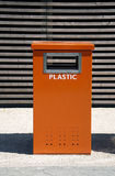 Orange trash can. For recycling plastic royalty free stock photos